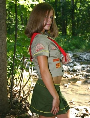 Crazy teenage doll teases next to a blast in her doll Guides uniform