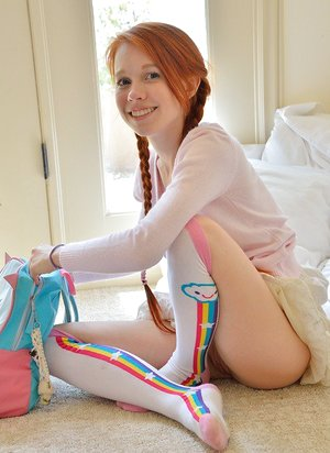 Youthfull redhead in pigtails flashes cunny at the playground & toys in socks