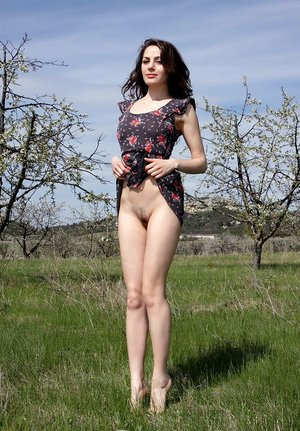 Dark-haired teenage Vani L hikes up skirt prior to posture naked in a area