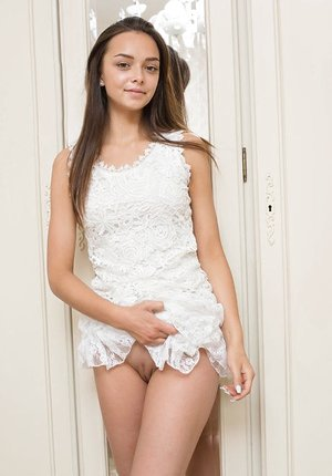 Cute teenage female Slava A removes her lacey clothes to model in the bare