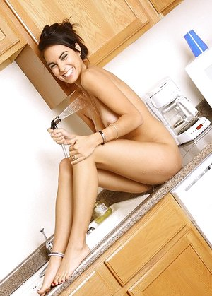 fantastic housewife Rachel washing her fantastic naked assets on the kitchen counter