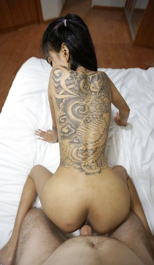 Slim Thai damsel with a back tat gets pulverized and packed with spunk by Farang