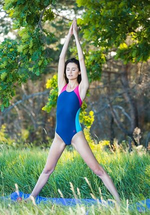 Chiseled brown-haired Cristin M models nude after outdoor yoga session