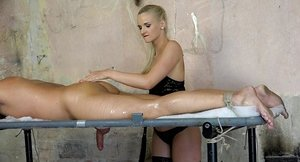 Doll superior Katy Sky tortures a held stud with a railing lash